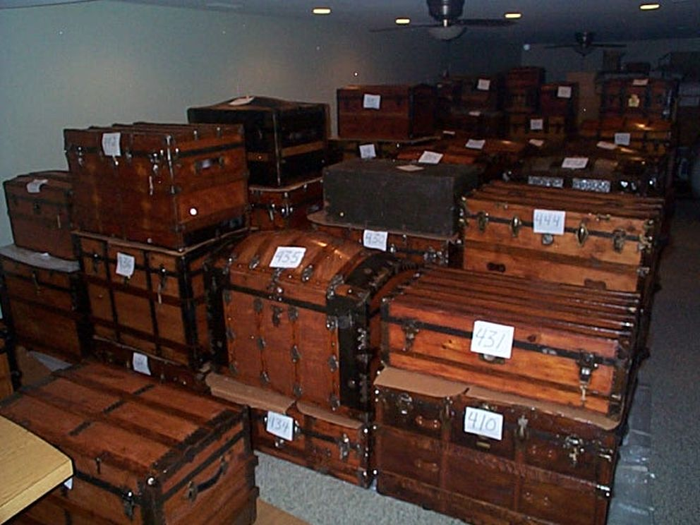 collection of restored and ready to ship antique steamer trunks