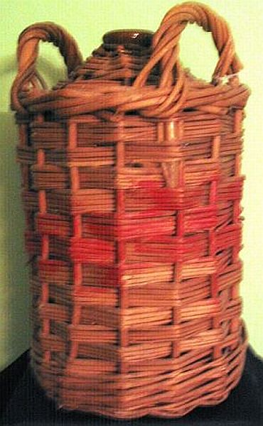 1940s brnir demijon jar encased in weaved cane which held pure british royal navy rum prior to mixing it into grog