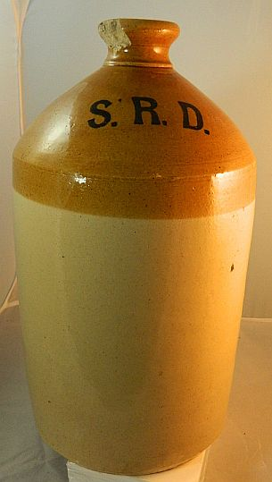1900-1940s brnir demijohn jar with wicker removed showing the initials S.R.D.