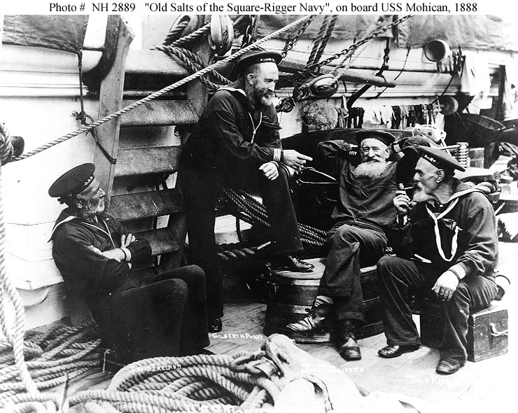 ca 1870s USS Mohican sailor John King sitting on his ditty box with Old Salts spinning tales and yarns
