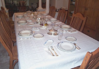 formal dining in ceremony table setting with navy-issued china and silverware
