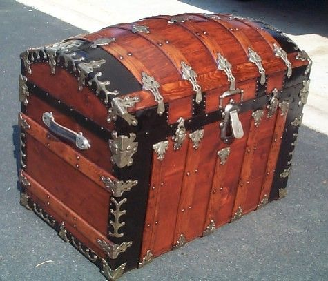 collection of restored and ready to ship antique trunks and this old trunk